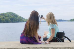 PL ODI6AP4 original 300x200 - Two young women enjoying a sunny afternoon in a riverside park. (Photo ©2015 George C. Anderson from PUSHLivingPhotos.com)