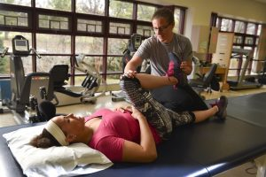PL 0CO0W7C original 300x200 - Young woman doing stretching exercises with the help of an instructor
