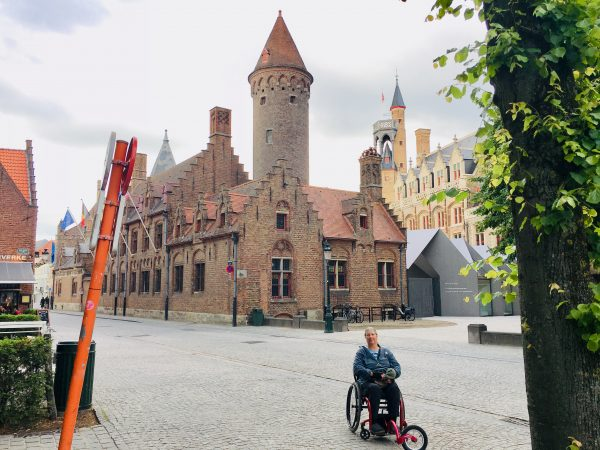 BrugesBelgiumMarketSquare 600x450 - PUSHLiving Podcast #26: Wheelchair Travel Guide for Yearning Travelers with Lilly Longshore