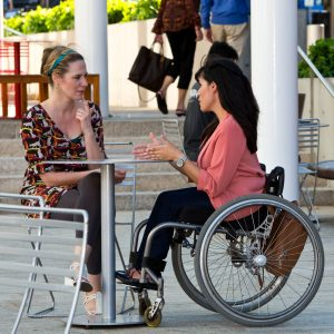 PL 0T6UHVG original 300x300 - Woman in a wheelchair in a cafe with her friend