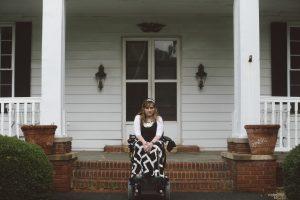 PL C61R5XC original 1 300x200 - Young woman in a power wheelchair enjoying her home garden