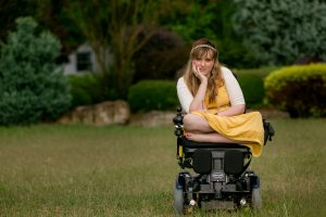 PL HZRV76V original 1 300x200 - Young woman in a power wheelchair enjoying her home garden