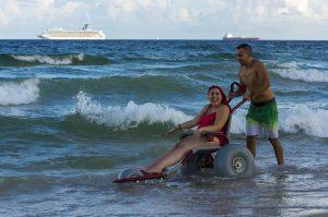 PL KSOTB3Y original 300x199 - Young woman enjoying the ocean in a beach wheelchair