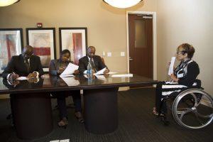 PL 1G2UQ1B original 300x200 - Woman using a wheelchair presenting in a board meeting