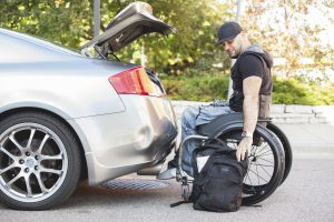 PL UUPUF27 original 1 300x200 - Young male college student in a wheelchair getting into his car