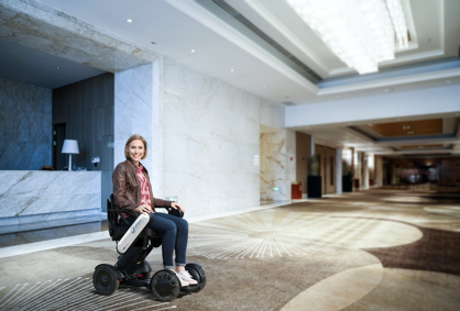 Woman in WHILL at hotel