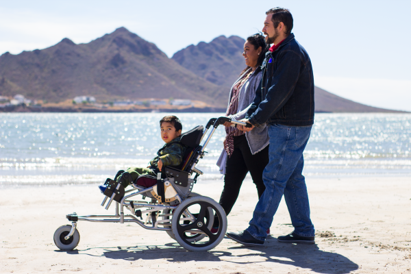 3 Karim and parents strolling beach 03 600x400 - PUSHLiving Podcast #30: Assistive Products: For Everyone, Everywhere with Keoke King
