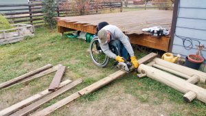 PL IM12VHS original 300x169 - Man using a wheelchair constructing a planter box